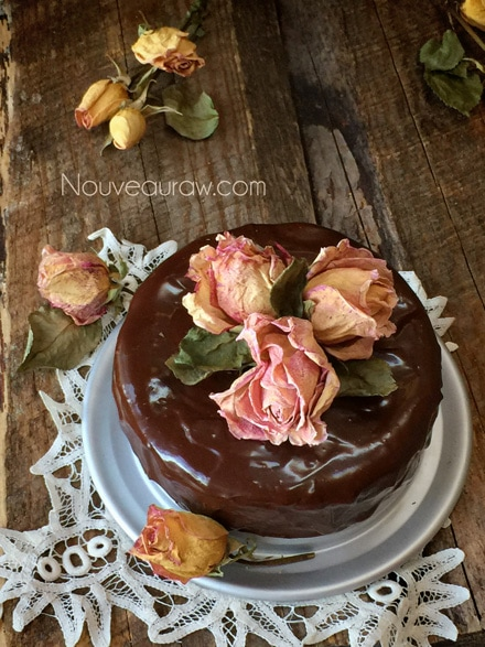 Artsistic & Delicious Raw Flourless Chocolate Cake with Ganache Frosting decorated with organic dried rose petals