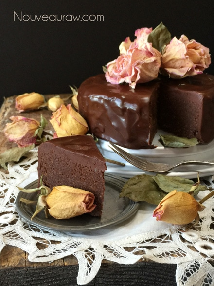 A Heavenly Piece of Raw Flourless Chocolate Cake with Ganache Frosting decorated with organic dried rose petals