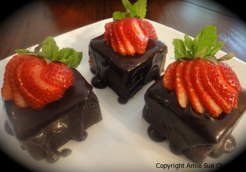 Raw Gluten-Free Chocolate Cake  with Strawberry Apricot Jam  topped with sliced strawberry, hard to resist