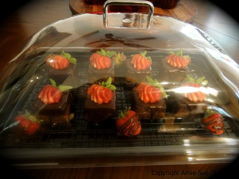 Raw Gluten-Free Chocolate Cake  with Strawberry Apricot Jam topped with sliced strawberries ready to share with friends