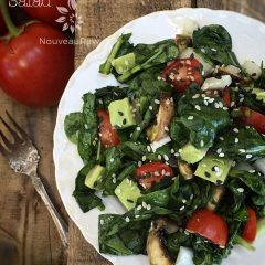raw vegan Marinaded Wilted Spinach Mushroom Salad served on a white plate