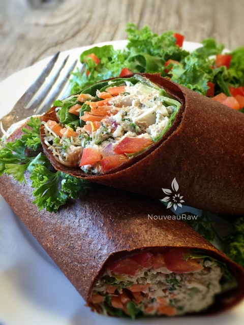 a close up of the raw vegan rolling the Not Tuna - but close! - Sandwich cut in half and plated
