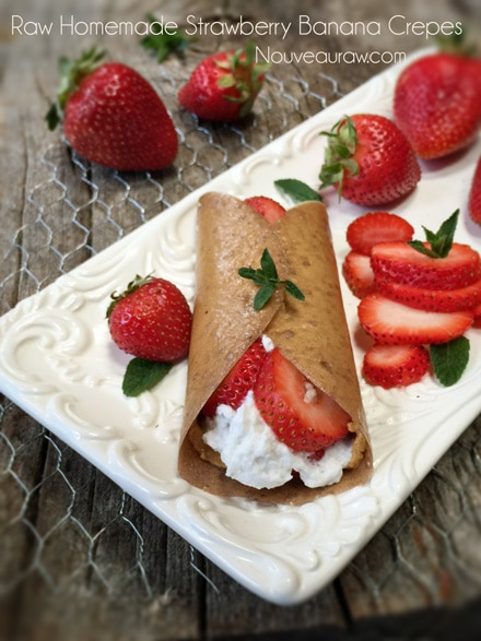 raw vegan Banana Wraps displayed with coconut whip cream and fresh strawberries