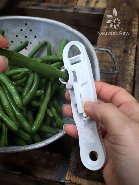 This is the green bean splitting machine that I used to cut one bean into four. This helps with softening them as well. You poke the bean into the hole...