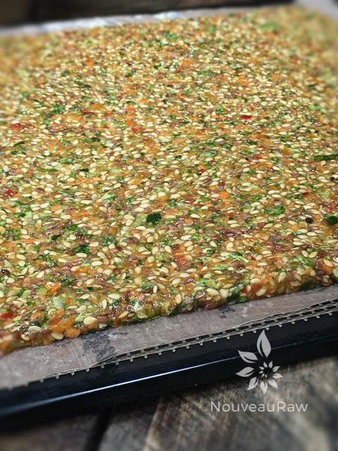 Abundant-Veggie-Flax-Crackers-spreading-crackers