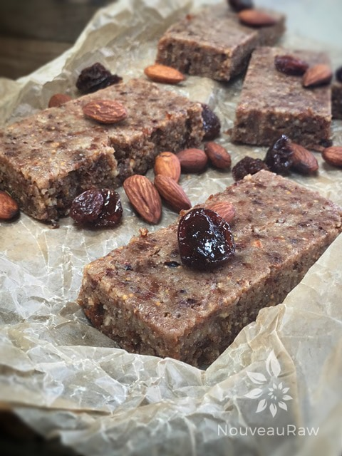Raw fig and cherry bars displayed on parchment paper ready to eat