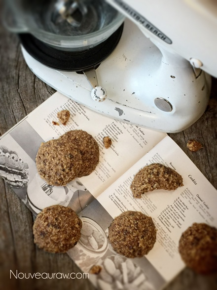 raw vegan Breakfast Nook Cookies displayed with an antique mixer