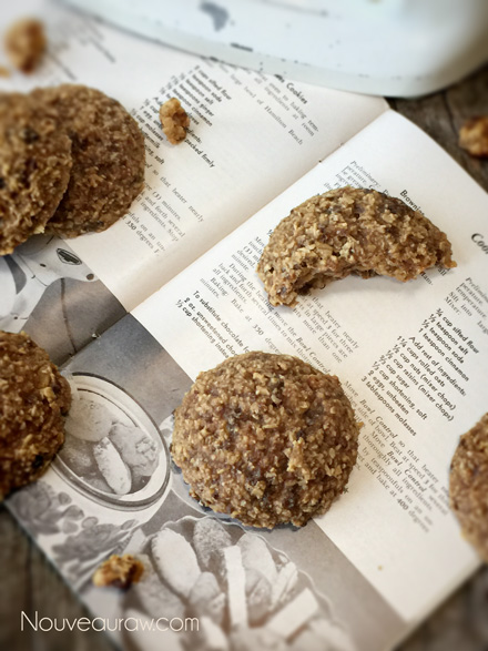 a close up of raw vegan Breakfast Nook Cookies displayed on an old cookbook