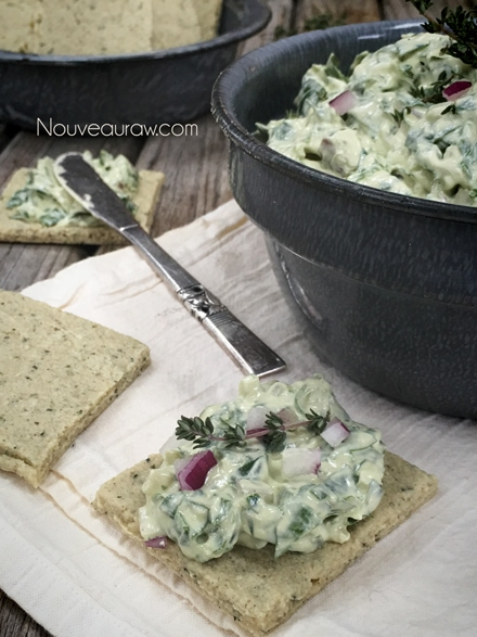 raw, vegan Spinach Dip served on raw, gluten-free crackers