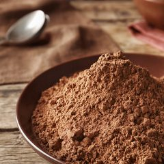 cacao-powder piled in a wooden bowl