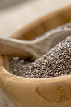 chia seeds close up in wooden bowl