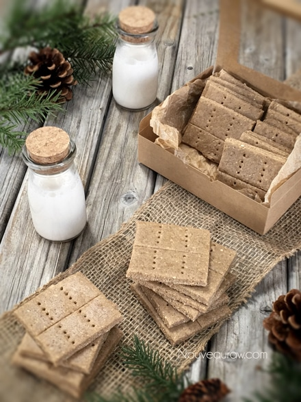 raw gluten free Graham Crackers displayed on a wooden table