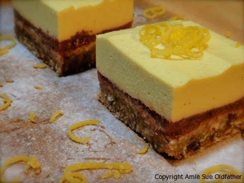 Raw Gluten-Free Lemonberry Coconut Bar with Lemon Frosting Pieces ready to eat