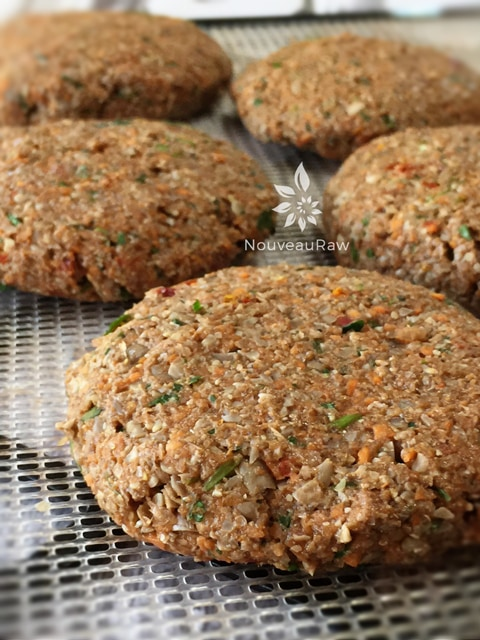 a close up of a dehydrator tray full of raw vegan Nutless Veggie Burger Patties