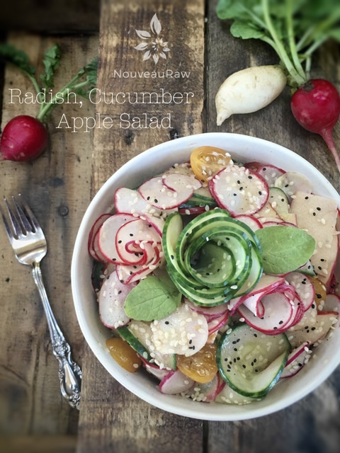 raw vegan fresh Radish, Cucumber, Apple Salad served in a white bowl on a wooden table