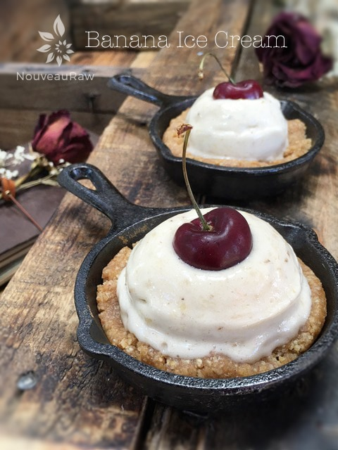 raw vegan Banana Ice Cream served on top of a gluten-free raw cookie in a cast iron skillet