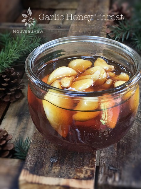How to soothe sore throat - raw vegan Garlic Honey Throat, Cold and Flu Remedy displayed on barn wood