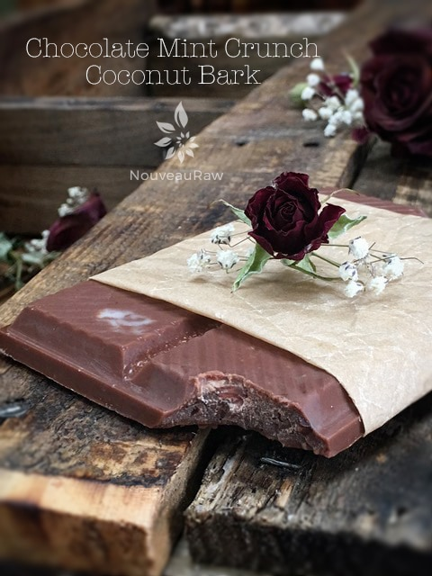 Raw, vegan, gluten-free, nut-free, sugar-free Chocolate Mint Crunch Coconut Bark presented on wooden table with roses