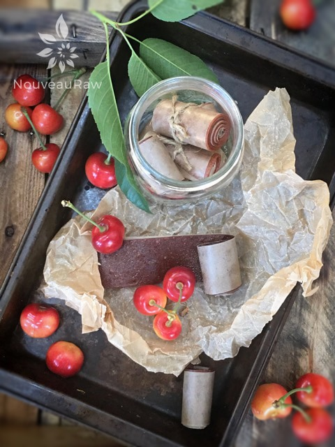 a beautiful display of fruit leather and fresh cherries