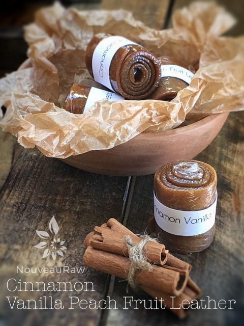 Cinnamon Vanilla Peach Fruit Leather rolled up and presented in a wooden bowl (raw, vegan, gluten-free, nut-free)