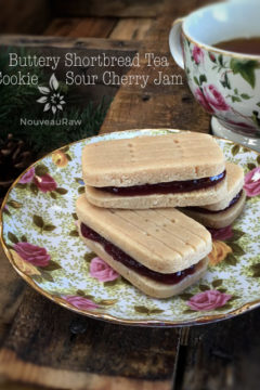 raw vegan Buttery Shortbread Tea Cookie with Sour Cherry Jam displayed on fine china