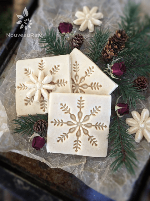 raw vegan Christmas Butter Spritz Cookies on a cookie tray