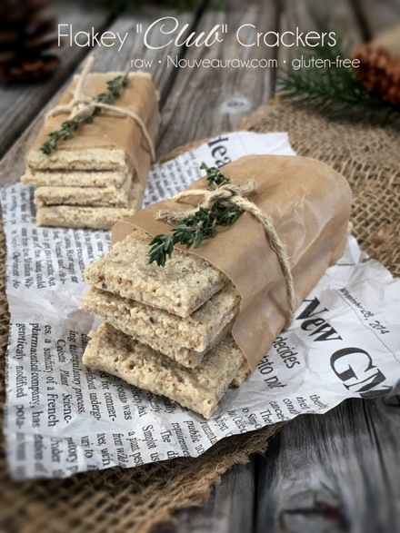 gluten free Flakey Club Crackers displayed on newspaper and a wooden table