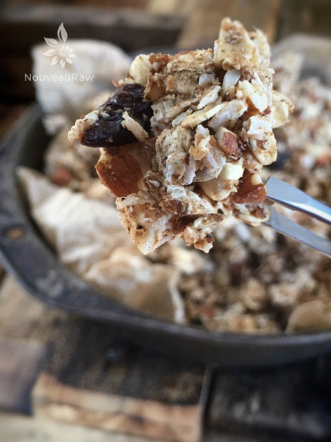 a close up of raw gluten-free Nutty Gingerbread Granola served ina pie pan