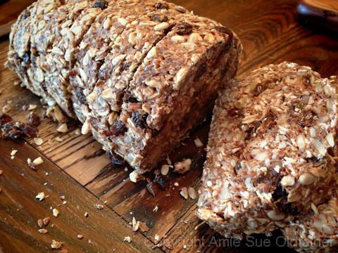 Raw Gluten-Free Seed Of Life Bread on a Board Slice
