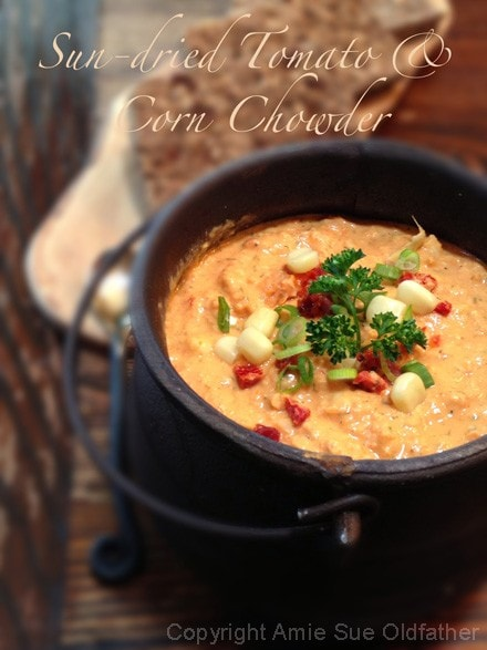 Raw, Dairy-Free, Gluten-Free, Soy-Free, Vegan Sun-dried Tomato & Corn Chowder served in a cast iron kettle