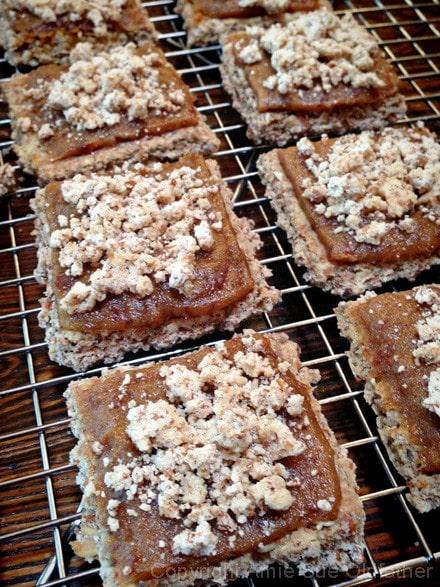adding the crumble to the Raw vegan gluten-free Apple Streusel Coffee Bar