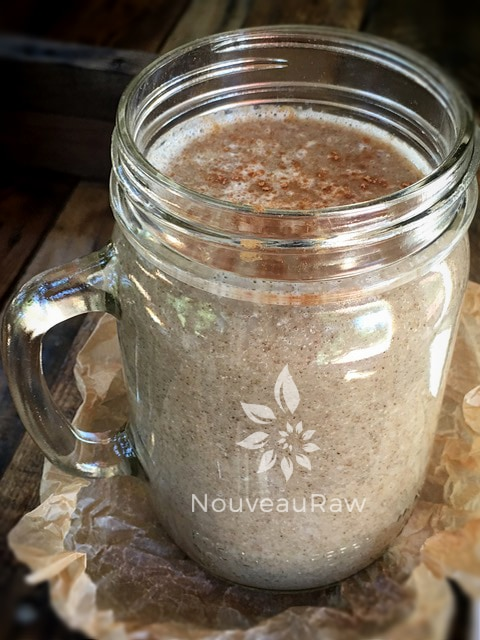 large mug of energizing chia seed drink in a mason jar mug with cinnamon on top