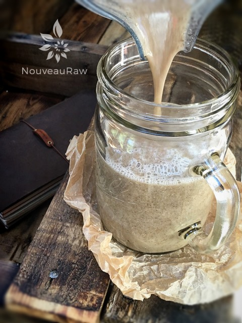 pouring this energizing chia seed drink into a mason jar mug