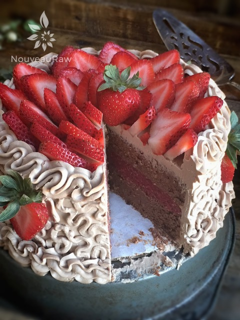 Inside of Raw Hazelnut Cardamom and Strawberry Layered Cake decorated with fresh organic strawberries
