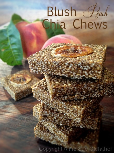 raw vegan Blush Peach Chia Chews stacked up on a wooden table