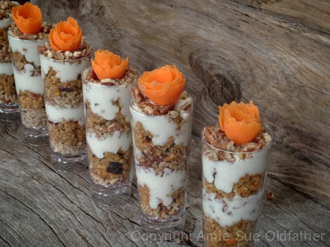 Highly enjoyable Raw Gluten-Free Buttery Walnut Carrot Cake Parfait decorated with carrot flower on top