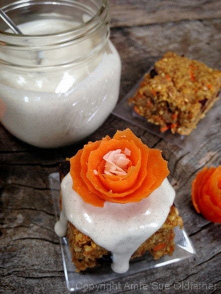 Raw Gluten-Free Buttery Walnut Carrot Cake Bars decorated with carrot flower, so pretty