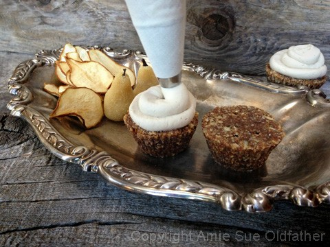 Decorating Raw Hazelnut Pear Cake with Velvety Honey Pear Frosting