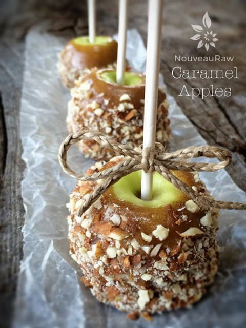 raw vegan Caramel Apples displayed on a wooden board and wax paper