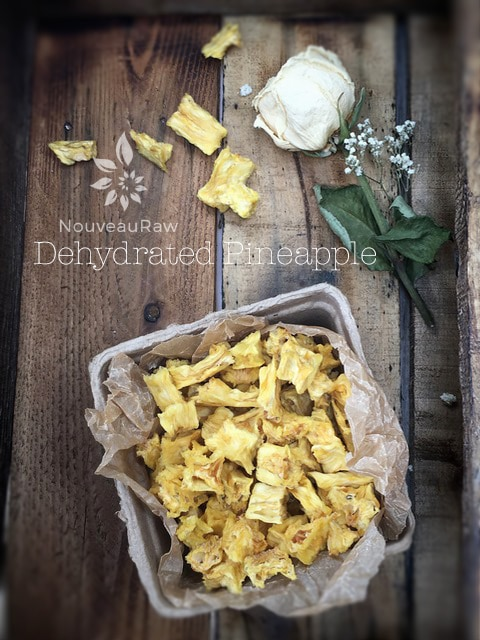 a top view of pineapple chunks displayed on barn wood
