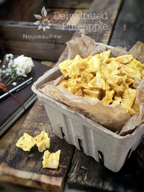 dried pineapple pieces in a container
