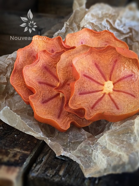 Dried Fuyu Persimmons displayed on wooden table