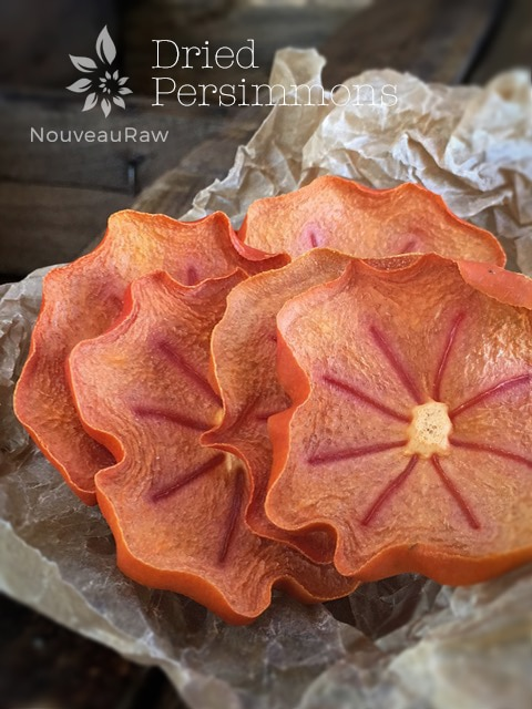 Dehydrated Fuyu Persimmons presented on brown parchment paper