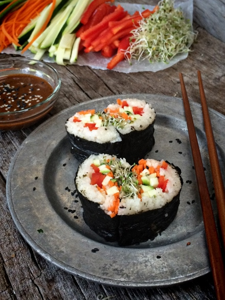 Raw, vegan, and gluten-free sushi hearts with almond dipping sauce