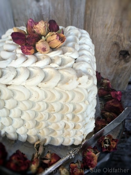 Pretty, Rich Raw Five Layer Petal Cake decorated with organic dried rose petals