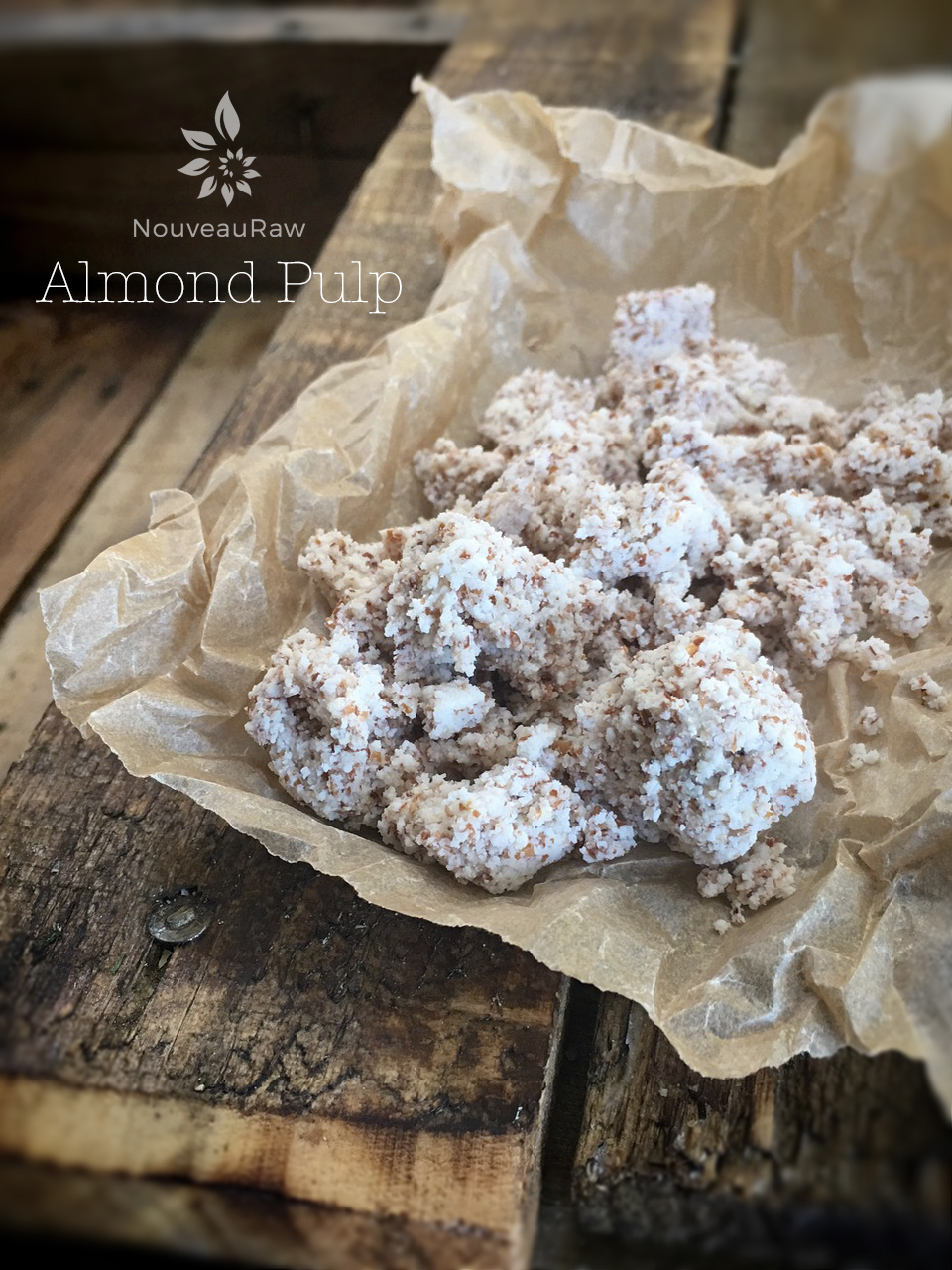 wet almond pulp on a piece of parchment paper
