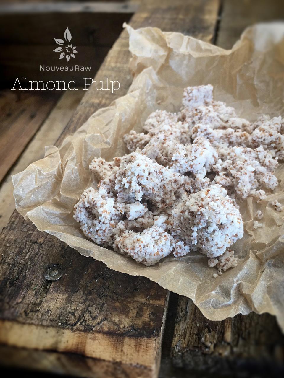 wet almond pulp on a piece of parchment paper