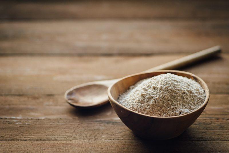 oat-flour-in-a-wooden-bowl