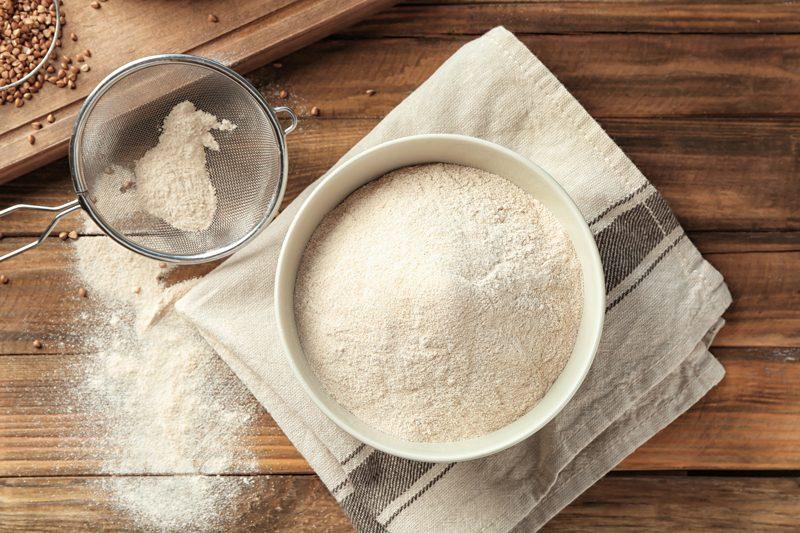 buckwheat-flour-on-wooden-cutting-board
