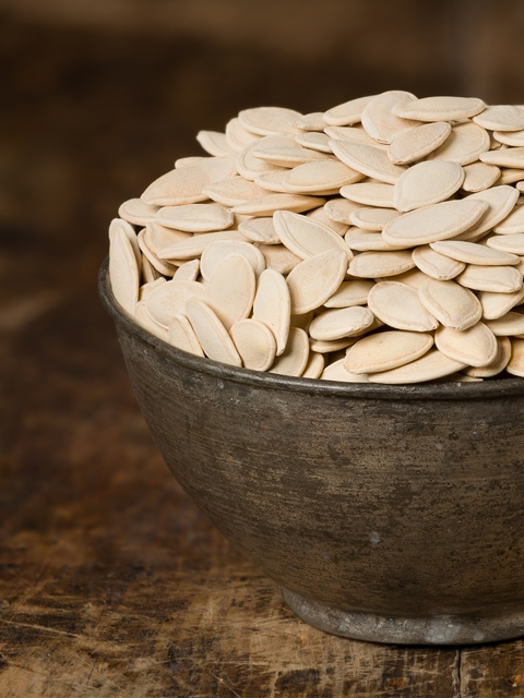 close up of pumpkin-seeds in a bowl